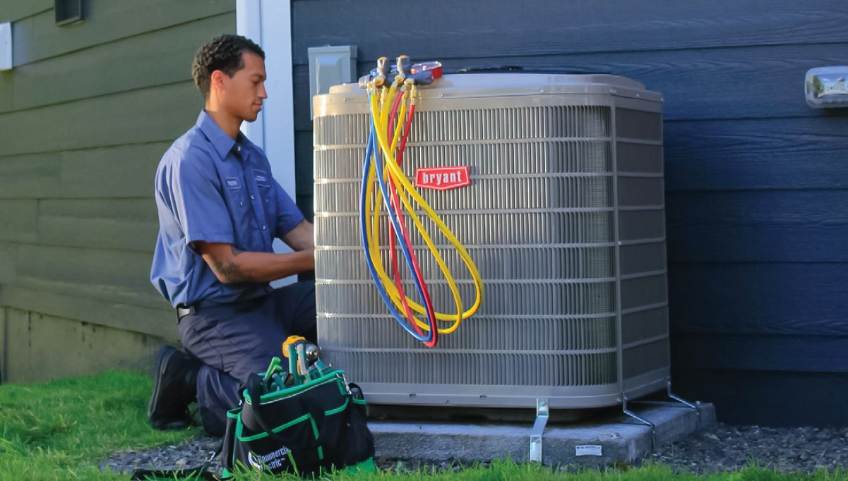 technician servicing HVAC equipment